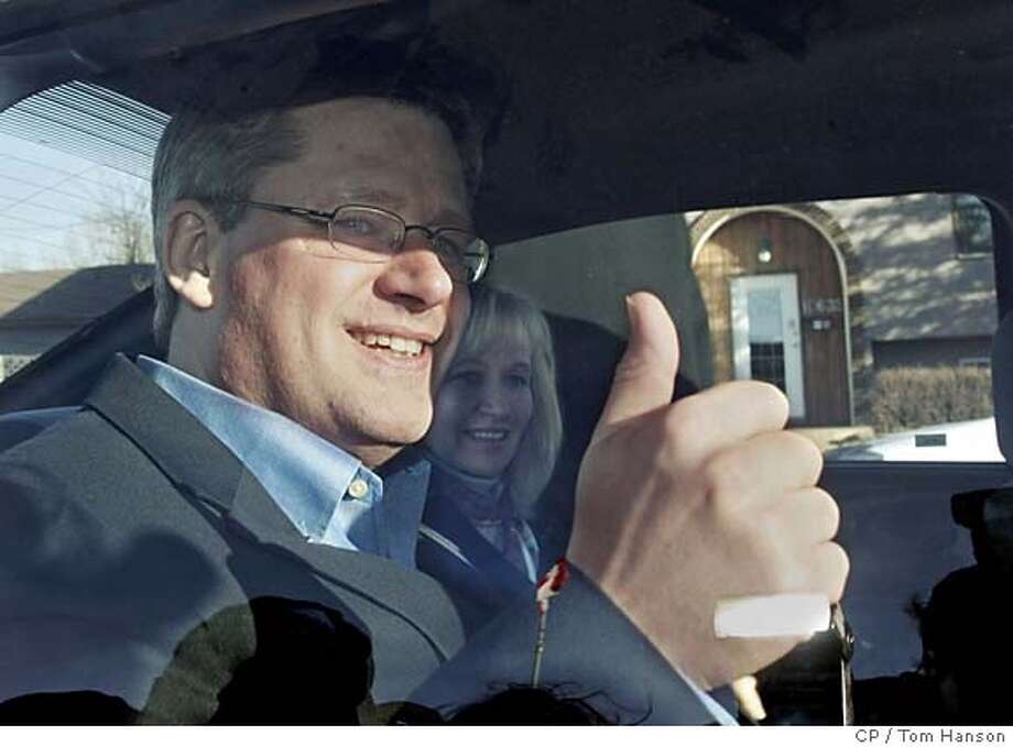 Canada's Conservative party leader Stephen Harper gives the thumbs-up from his car window after his wife Laureen Teskey cast her ballot at a polling station in Calgary, Alberta, Monday, Jan. 23, 2006. (AP PHOTO/CP, Tom Hanson) COM Photo: TOM HANSON