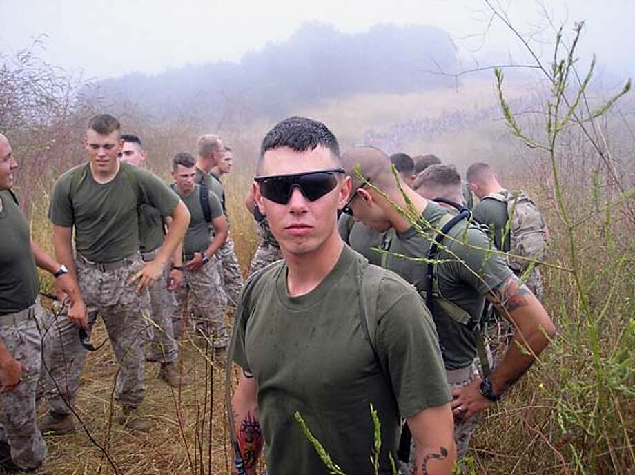 Photo of U.S. Marine LCPL Brandon Dewey in the field. Photo: Handout
