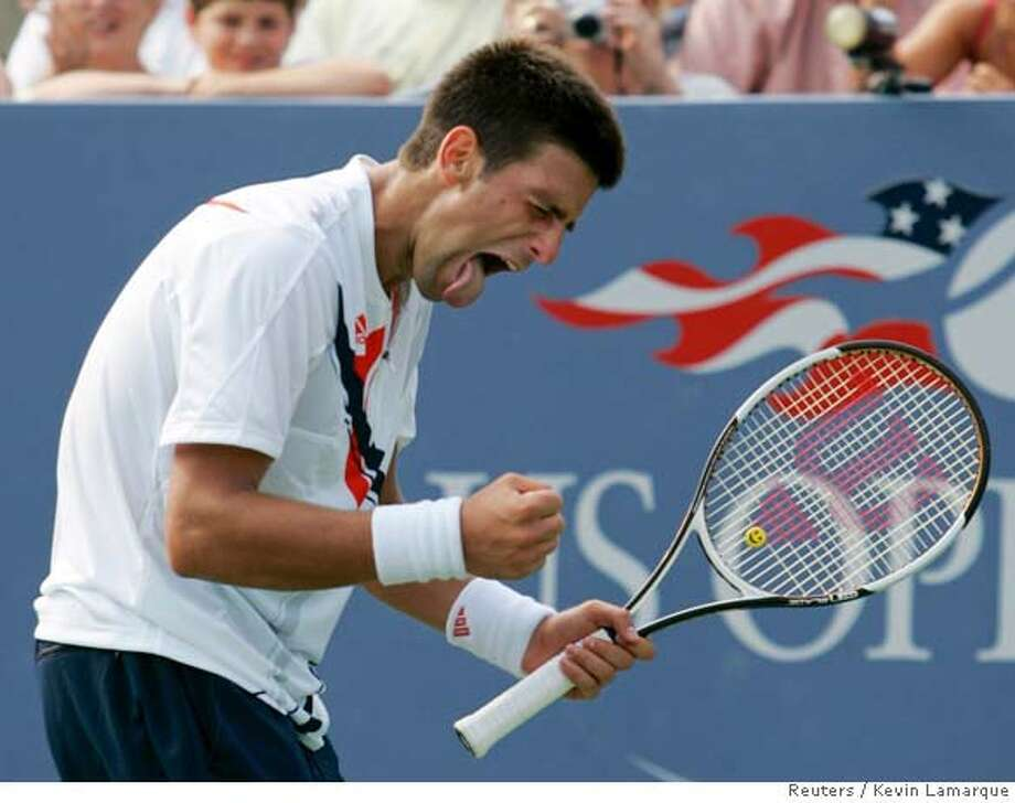 Novak Djokovic of Serbia celebrates during his victory over Radek Stepanek of the Czech Republic at the U.S. Open tennis tournament in Flushing Meadows, New York August 31, 2007. REUTERS/Kevin Lamarque (UNITED STATES) Photo: KEVIN LAMARQUE