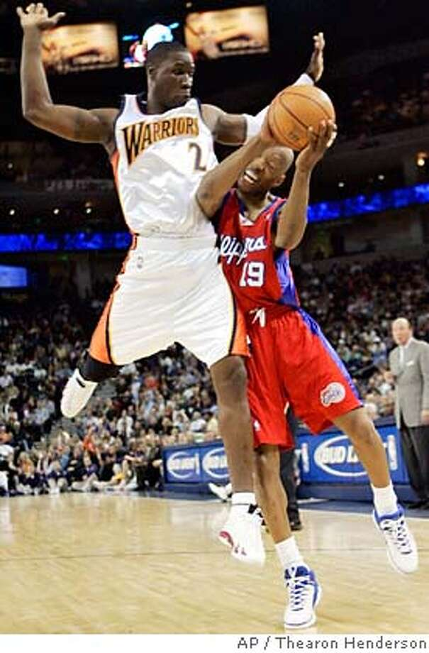 Los Angeles Clippers' Sam Cassell (19) draws the foul against Golden State Warriors' Mickael Pietrus (2) of France, during the second quarter of their basketball game in Oakland, Calif., Monday, Jan. 23, 2006. (AP Photo/Thearon Henderson) Photo: THEARON HENDERSON