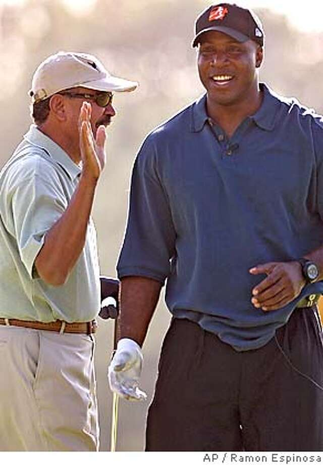 San Francisco Giants outfielder Barry Bonds, right, and Baseball Hall of Famer and former San Francisco Giants' pitcher Juan Marichal laugh during the 20th annual Juan Marichal Golf Classic in Juan Dolio, Dominican Republic, Saturday, Jan. 21, 2006. (AP Photo/Ramon Espinosa) ***EFE OUT*** Photo: RAMON ESPINOSA