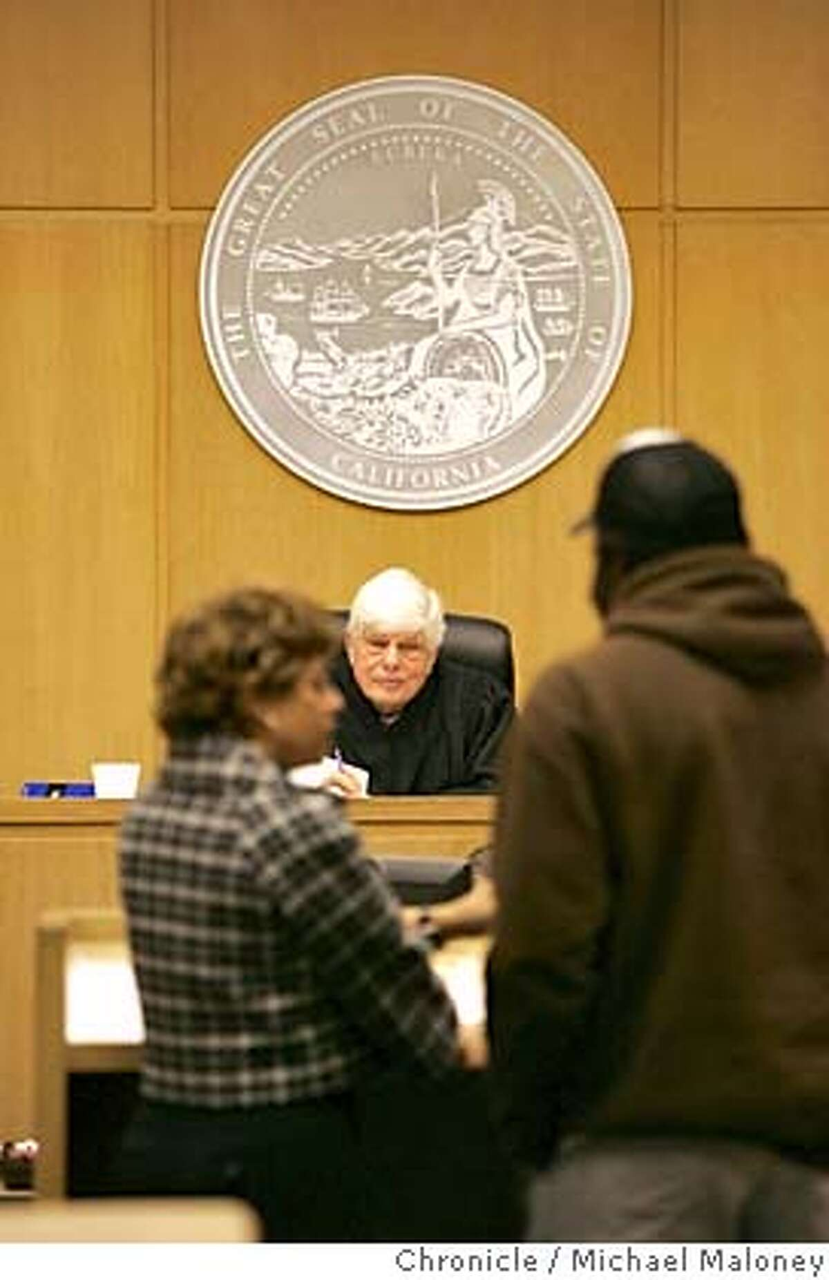 COURT_052_MJM.jpg Public Defender Jennifer Johnson (left) works with her clients in the Behavioral Health Court before Judge Herbert Donaldson. The Behavioral Health Court at the Hall of Justice is a two-year-old program in which criminal offenders who have mental health problems are given a chance to get into treatment programs and such, under the guidance of the DA and public defender's office, instead of being charged with a crime and prosecuted. If you stay in treatment and on your meds, you might graduate from the program and stay free instead of doing prison time. Event in San Francisco, CA Photo by Michael Maloney / The Chronicle MANDATORY CREDIT FOR PHOTOG AND SF CHRONICLE/ -MAGS OUT
