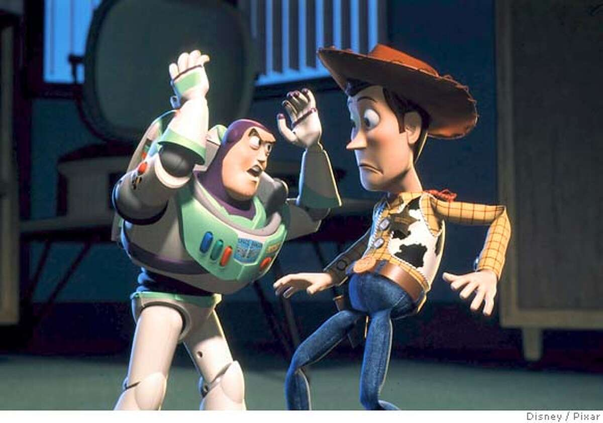 """Buzz Lightyear (L) reminds Woody that he is a toy in this undated file photo of a scene taken from """"Toy Story 2"""". The board of Walt Disney Co. has authorised Chief Executive Robert Iger to make an offer to buy Pixar Animation Studios Inc., and that is expected by January 24, 2006. REUTERS/Photo Courtesy Disney/Pixar/Handout/Files"""