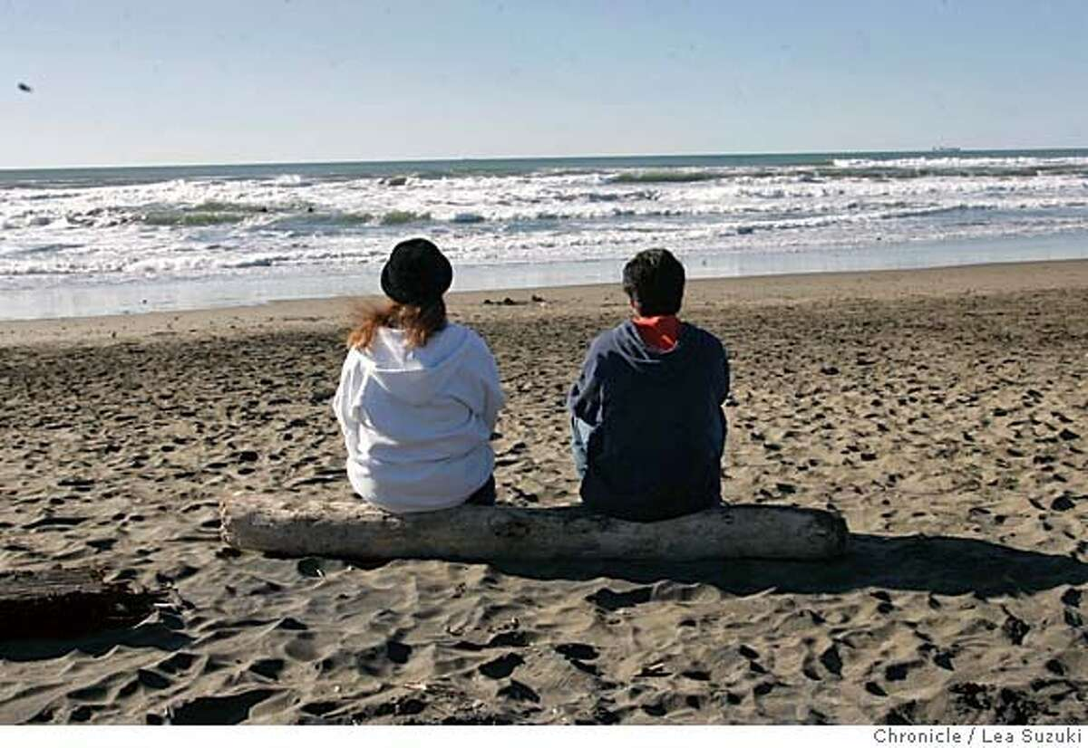From left: Raquel Ramirez and Manuel Rochin both of San Francisco, sit on a log and watch the view at Ocean Beach close to where Sloat crosses the Great Highway.. BRANT NOTE: I believe this is the log that Carrie was sitting on , from what she told me, when she noticed the body in the water. She says you can email the photo to her if you want to confirm. A surfer washes up on shore at Sloat at Great Highway on Ocean Beach. Photo taken on 1/22/06 in San Francisco, CA. Photo by Lea Suzuki/ The San Francisco Chronicle