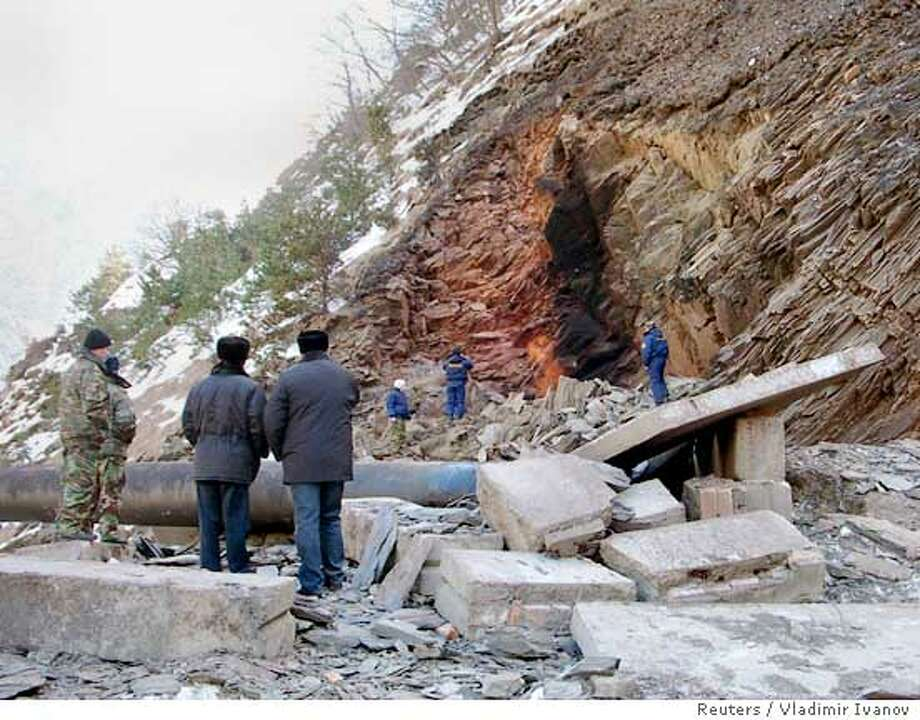 Russian Emergency Ministry workers inspect a pipeline which was knocked out overnight by two explosions in a mountainous part of North Ossetia, Russia January 22, 2006. Explosions in Russia's southern region of North Ossetia knocked out the main pipeline that exports Russian gas to Georgia and onward to its neighbour Armenia. REUTERS/Vladimir Ivanov Ran on: 01-23-2006  Russian emergency workers inspect a pipeline that was knocked out by two explosions in the mountains of North Ossetia. Photo: STRINGER/RUSSIA