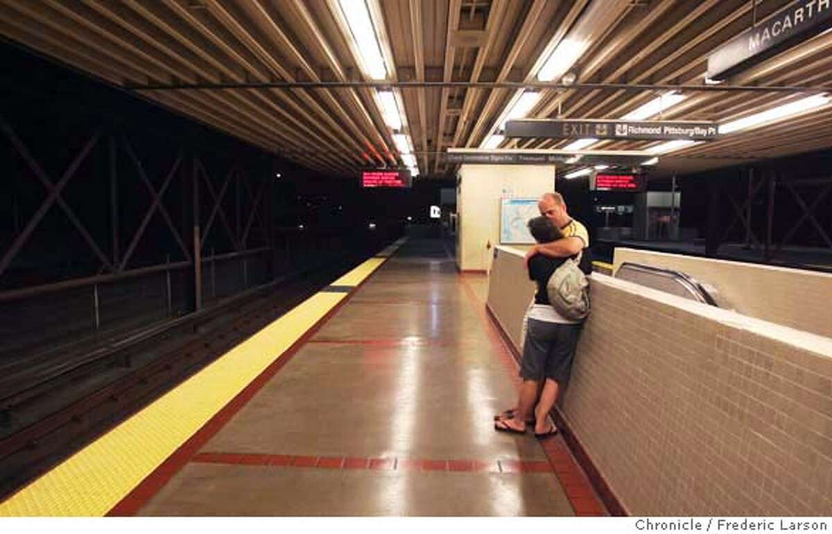 Julie Herbert and Bob McCallister of SF wait at the MacArthur Street Station for a Bart car to arrive. While workers raced to fill a gaping 350-foot hole they had demolished in middle of the Bay Bridge's upper deck Monday morning, Bay Area drivers avoided the chaos that might have come with the holiday-weekend closure of the region's key viaduct by staying off the roads in droves and taking BART. BART ran trains all night on Labor Day morning as when they are usually closed. Late night party goes packed the Powell Street station after last call at the bars and then packed the Bart stations for a safe ride home. 9/3/07 {Photographed by Frederic Larson} MANDATORY CREDIT FOR PHOTOGRAPHER AND SAN FRANCISCO CHRONICLE/NO SALES-MAGS OUT