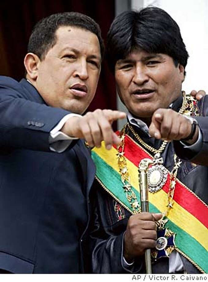 Venezuela's President Hugo Chavez, left, stands next to Bolivian President Evo Morales, right, as they stand in the balcony of the presidencial palace in La Paz, Bolivia on Sunday, January 22, 2006. (AP Photo/Victor R. Caivano) **EFE OUT** Photo: VICTOR R. CAIVANO