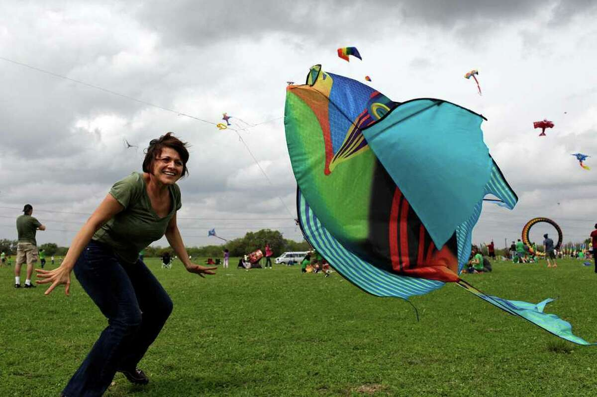 Carmen Sepulveda tries to get her son's kite to stay in the air during