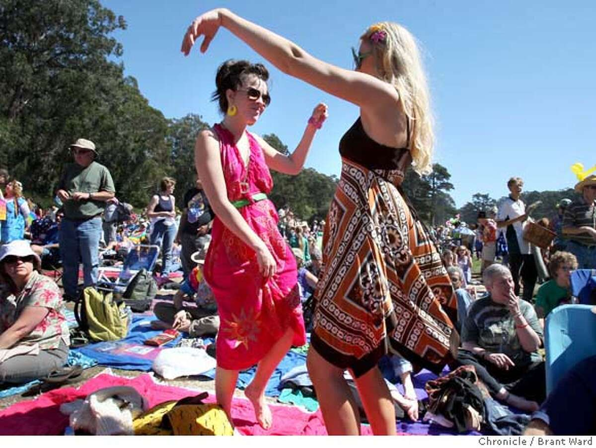 summeroflove_135.JPG Kae, left, and Heather danced to the music of the Rowan Brothers Sunday. A free concert celebrating the 40th anniversary of the San Francisco Summer of Love was held at Speedway Meadow in Golden Gate Park sunday. Thousands jammed the meadow to listen to bands of the 60s. {By Brant Ward/San Francisco Chronicle}9/2/07