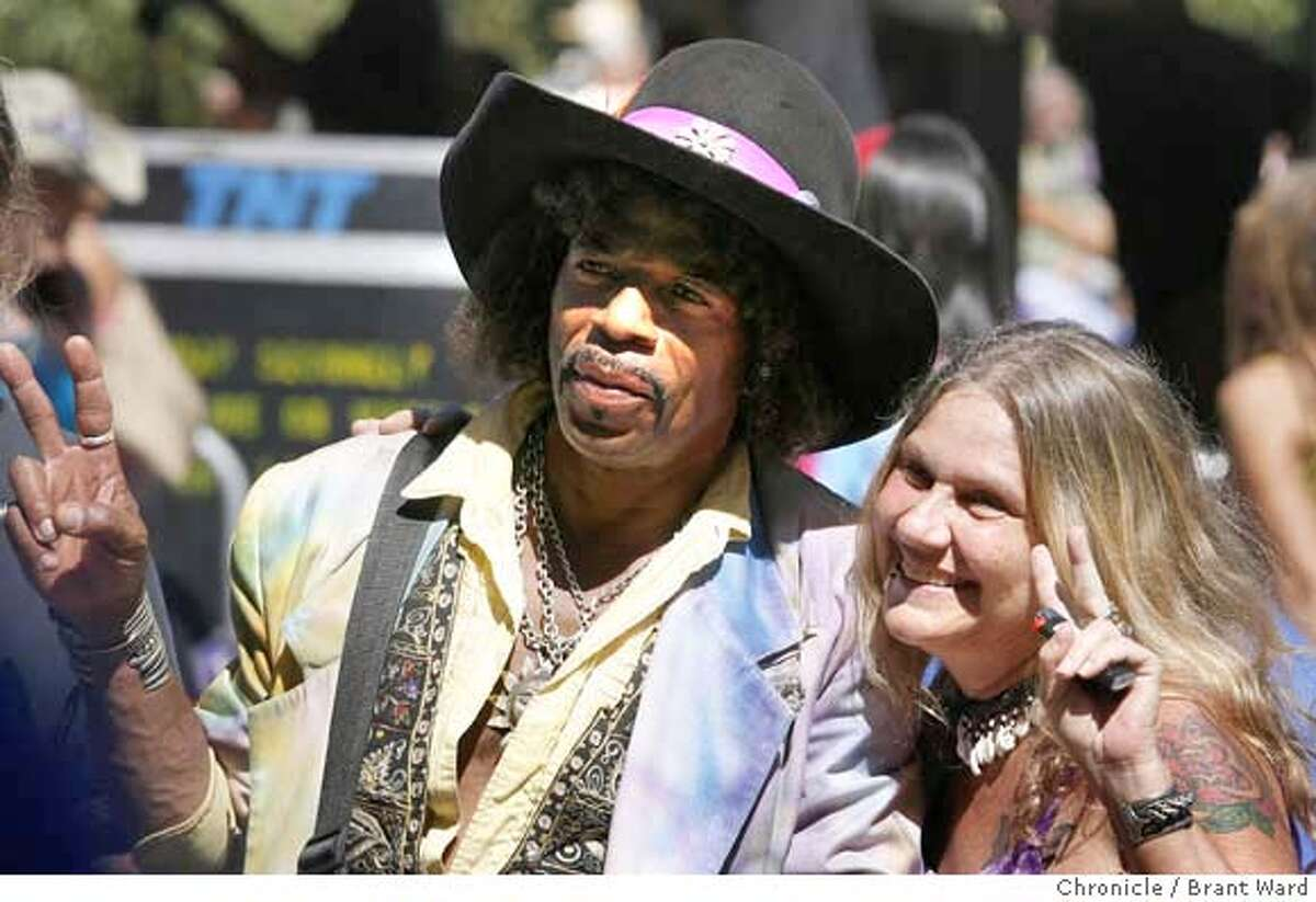A Jimi Hendrix wanna-be had his picture taken with a concert attendee Sunday. A free concert celebrating the 40th anniversary of the San Francisco Summer of Love was held at Speedway Meadow in Golden Gate Park sunday. Thousands jammed the meadow to listen to bands of the 60s. {By Brant Ward/San Francisco Chronicle}9/2/07