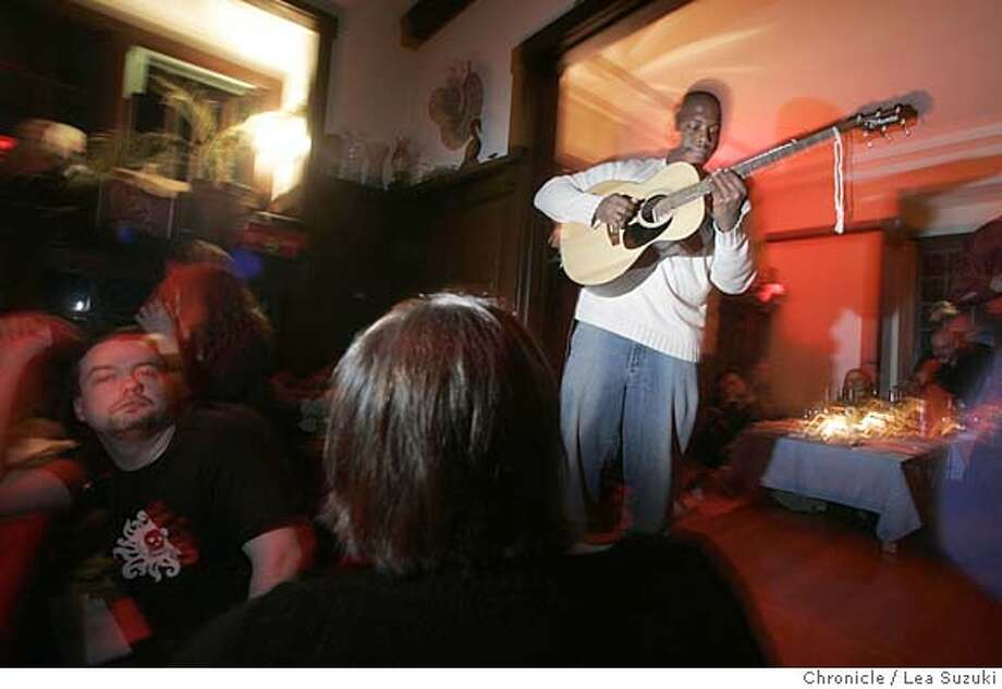 Quinn Deveaux performs between serving of the Salad and Entree.  :� This is the third assignment for a trend story on underground (i.e. illegal) restaurantsd being run out of people's homes.  Lea Suzuki has previously shot this, is working Monday night and would like to shoot the assignment. (Paul Chinn has also shot it, but looks like he is off next week.)  The story looks at the growing trend, both locally and internationally, oif chefs and others running secret restaurants in homes and other locations. Getting in is all anbout who you know (and who they know.) Some aim for gourmet food, others for atmosphere.  Monday night, we hang out with Gourmet Ghetto operator Jeremy Townsend at his home in Rockridge. He's been hosting $25 BYOB dinners on Monday nights for over a year. It started with friends and family but now has a following of many people he's never met before. They feed abeout 25-30 people. Photo taken on 11/21/05 in Oakland, CA. Photo by Lea Suzuki/ The San Francisco Chronicle Photo: Lea Suzuki