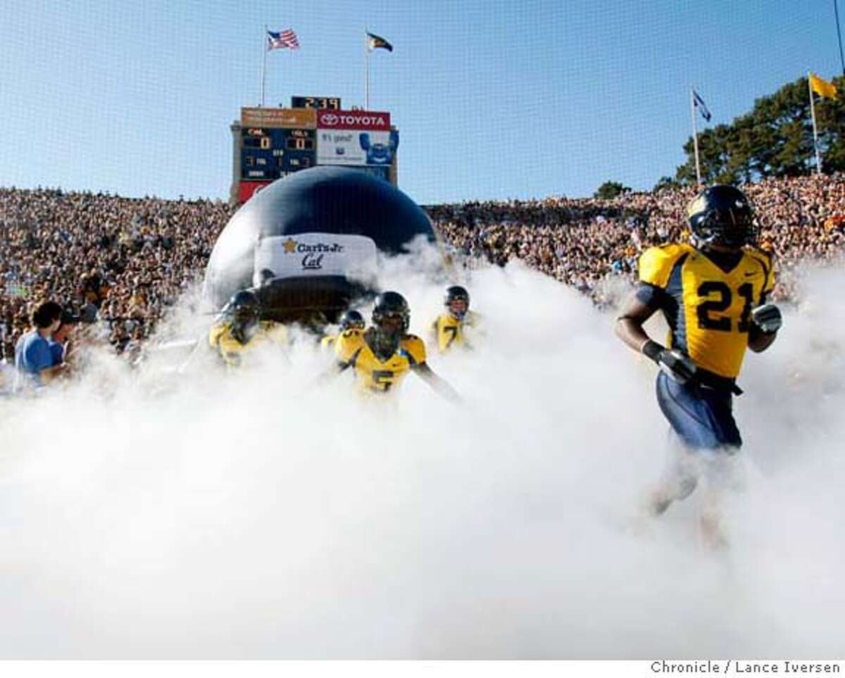CALFOOTBALL_263344.JPG Cal's 21 James Montgomery leads the bears onto the field Saturday. #12 University of California's Vs. #15 Tennessee at Memorial Stadium in Berkeley game. SEPT 9, 2007. Cal won 45-31. Lance Iversen/The Chronicle (cq) SUBJECT 9/01/07,in BERKELEY. CA. MANDATORY CREDIT PHOTOG AND SAN FRANCISCO CHRONICLE/NO SALES MAGS OUT