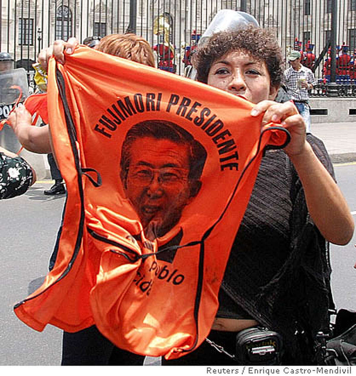 Supporter of former President Alberto Fujimori holding a T-Shirt with his picture, protests in front of the Government Palace in Lima, January 11, 2006. Peru's election board on Tuesday rejected a bid by Fujimori to run for president in April on the grounds that he is barred from holding public office until 2011. REUTERS/Enrique Castro-Mendivil 0