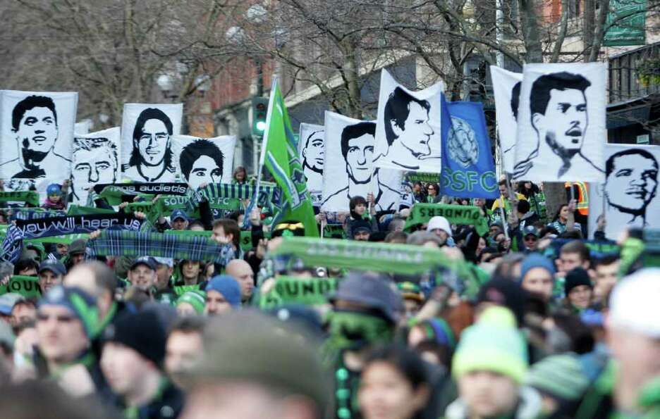 Emerald City Supporters march to the match during the Seattle Sounders MLS season opener against Tor
