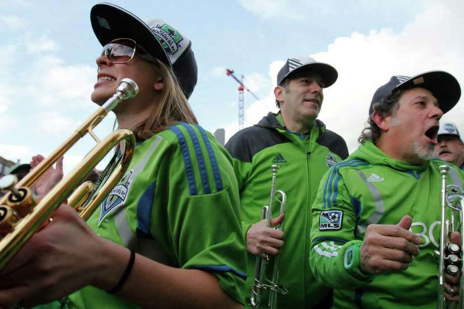 Members of Sound Wave, the Seattle Sounders band, play during the Seattle Sounders MLS season opener against Toronto FC on Saturday, March 17, 2012 at CenturyLink Field in Seattle. Photo: JOE DYER / SEATTLEPI.COM