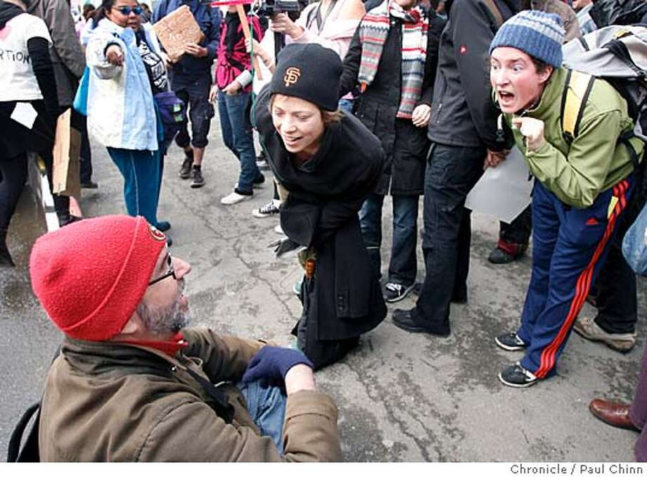 """Pro-choice demonstrators (right) confront a man identifying himself as Lord Daniel, who was calling them """"guilty of murder"""" during the second annual Walk For Life anti-abortion march in San Francisco, Calif. on 1/21/06.  PAUL CHINN/The Chronicle Photo: PAUL CHINN"""