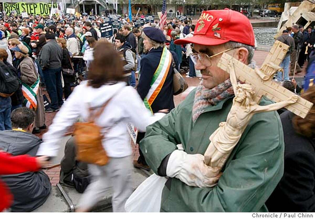 Robert Powers clutches a crucifix as he waits for the second annual Walk For Life anti-abortion march to start in San Francisco, Calif. on 1/21/06. PAUL CHINN/The Chronicle