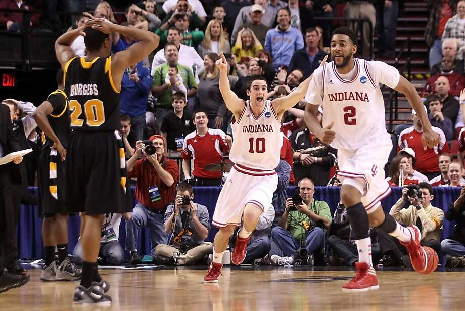 PORTLAND, OR - MARCH 17:  Will Sheehey #10 and Christian Watford #2 of the Indiana Hoosiers celebrate along with their teammates after the Hoosiers as Bradford Burgess #20 of the Virginia Commonwealth Rams is dejected after the Hoosiers 63-61 during the third round of the 2012 NCAA Men's Basketball Tournament at the Rose Garden Arena on March 17, 2012 in Portland, Oregon.  (Photo by Jed Jacobsohn/Getty Images) Photo: Jed Jacobsohn, Getty Images