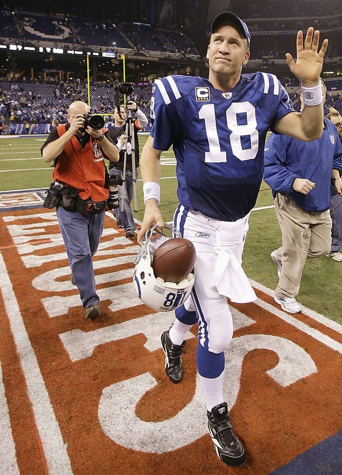 FILE - In this Jan. 16, 2010, file photo, Indianapolis Colts quarterback Peyton Manning waves as he walks off the field after the NFL divisional football playoff game against the Baltimore Ravens in Indianapolis. The Peyton Manning era in Indianapolis is expected to end, according to a report. Citing anonymous sources, ESPN reported Tuesday, March 7, 2012, that the Colts plan to hold a news conference Wednesday to announce the long-expected decision. Manning is expected to attend. (AP Photo/Darron Cummings, File)