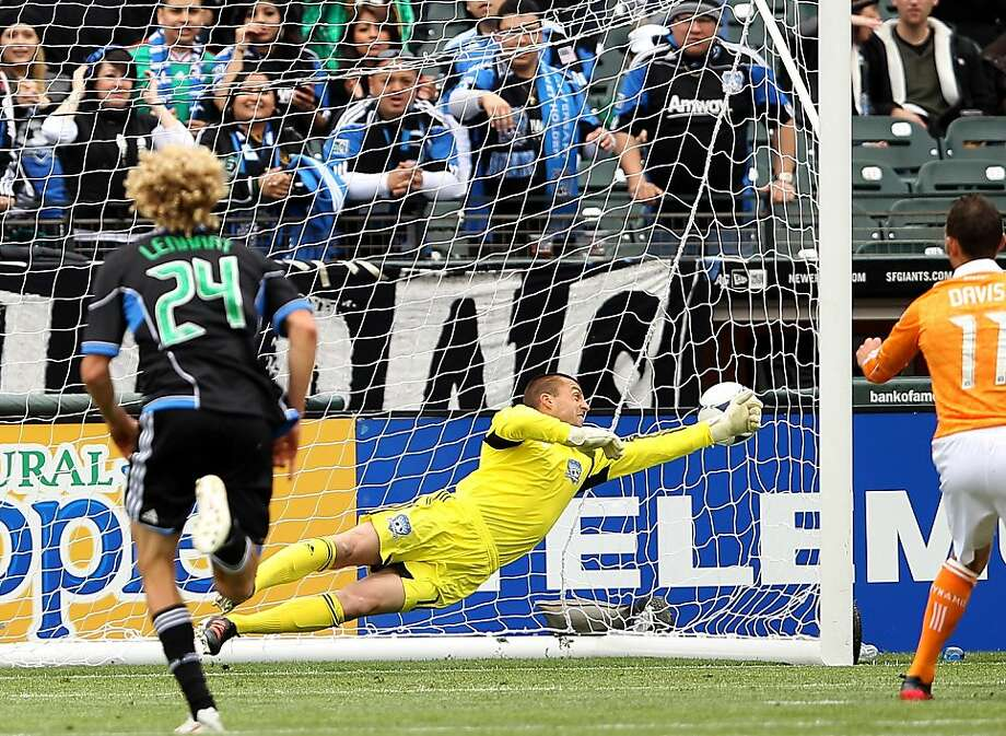 SAN FRANCISCO, CA - MARCH 17:  Jon Busch #18 of the San Jose Earthquakes can't stop a penalty kick taken by Brad Davis #11 of the Houston Dynamo at AT&T Park on March 17, 2012 in San Francisco, California.  (Photo by Ezra Shaw/Getty Images) Photo: Ezra Shaw, Getty Images