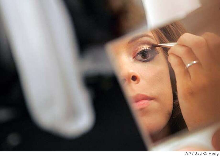 Jennifer Berry, Miss Oklahoma, fixes her make-up after the rehearsals for the 2006 Miss America Pageant at Aladdin Resort & Casino in Las Vegas on Thursday, Jan. 19, 2006. Fifty-two contestants will compete in the annual Miss America pageant on Saturday, Jan. 21, 2006, in Las Vegas. (AP Photo/Jae C. Hong) Photo: JAE C. HONG