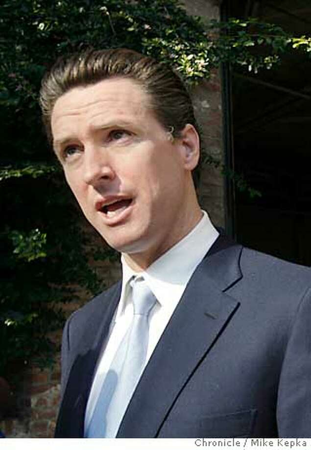 After meeting meeting with cable car employees union reps at the San Francisco cable car barn, Mayor Gavin Newsom talks to the media about statements he made accusing cable car conductors of embezzling ticket money.  San Francisco on 1/21/06. Mike Kepka / The Chronicle Photo: Mike Kepka