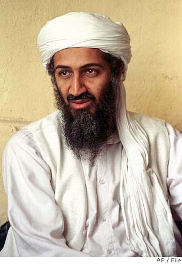 ** CAPTION CORRECTION, CORRECTS TITLE TO AL-QAIDA LEADER, NOT EXILED SAUDI DISSIDENT ** FILE ** Al-Qaida leader Osama bin Laden is seen in this April 1998 file photo in Afghanistan. Al-Jazeera aired an audiotape purportedly from Osama bin Laden on Thursday, Jan. 19, 2006, saying al-Qaida is making preparations for attacks in the United States but offering a truce to rebuild Iraq and Afghanistan. (AP Photo) APRIL 1998 FILE PHOTO Photo: AP