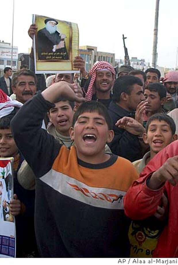 With a portrait of the Shiite Grand Ayatollah Sayyid Ali Husaini Sistani, local Shiites celebrate their majority winnings in the Dec. 15 parliamentary elections after the results were released, Friday, Jan. 20, 2006, in the holy city of Najaf, 160 kilometers (100 miles) south of Baghdad, Iraq. The election commission announced Friday that an alliance of Shiite religious parties won the biggest number of seats in Iraq's new parliament but too few to rule without coalition partners.(AP Photo/Alaa al-Marjani) Ran on: 01-21-2006  Shiites hold aloft a portrait of Grand Ayatollah Ali al-Sistani as they celebrate winning a big majority in last month's election. Photo: ALAA AL-MARJANI