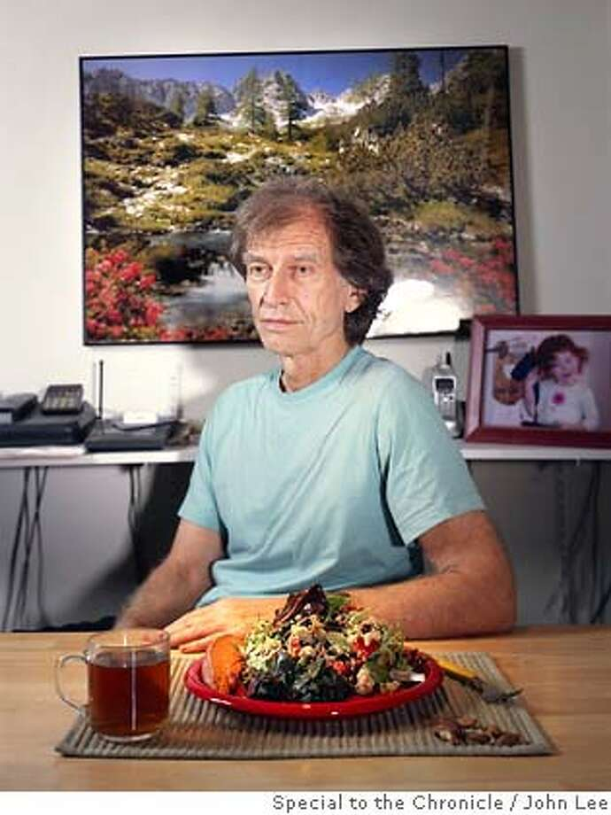 CALORIE_RESTRICTION_03_JOHNLEE.JPG  COTATI, CALIFORNIA - AUG 8: Calorie restriction practitioner Barry Gamble (cq), sitting at his dining table with a typical day's worth of food on his plate.  By JOHN LEE/ Photo: John Lee