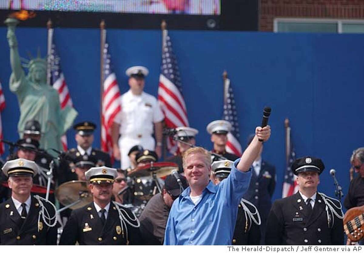 Radio personality Glenn Beck, center, gets the crowd going, Saturday, May 24, 2003, during the