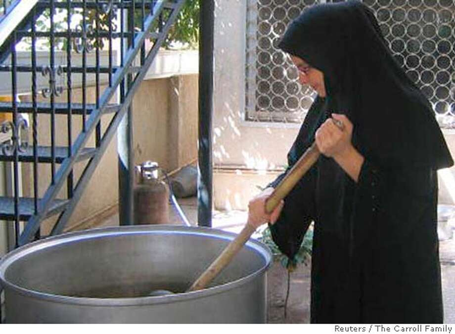 A 2005 handout photo shows Christian Science Monitor freelance writer Jill Carroll helping to prepare traditional food at the home of Iraqi friends. Carroll was abducted by unknown gunmen in Baghdad on January 7, 2006 and her Iraqi interpreter Allan Enwiyah was killed during the kidnapping. U.S. forces in Iraq said on January 18 they were holding eight women prisoners, after the abductors of Carroll threatened to kill her if the authorities did not free all Iraqi women within 72 hours. FOR EDITORIAL USE ONLY REUTERS/The Carroll Family/Handout 0 Photo: HO