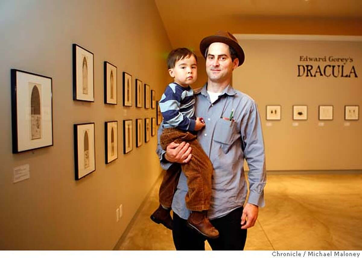 """Tom Downs, the author of """"Walking San Francisco"""" with his son Liam (3 1/2 years old) at one of his favorite hangouts, the Cartoon Art Museum in San Francisco. Photo taken on 8/22/07 in San Francisco, CA Photo by Michael Maloney / San Francisco Chronicle ***Tom Downs, Liam Ran on: 09-02-2007 Tom Downs, with his son, Liam, visits the Cartoon Art Museum to see original works by cartoonists Chuck Jones, Charles M. Schulz, R. Crumb and Daniel Clowes. Ran on: 09-02-2007"""