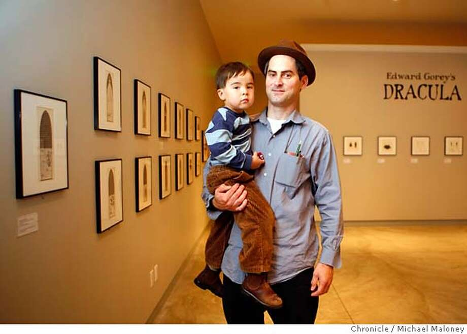 "Tom Downs, the author of ""Walking San Francisco"" with his son Liam (3 1/2 years old) at one of his favorite hangouts, the Cartoon Art Museum in San Francisco.  Photo taken on 8/22/07 in San Francisco, CA  Photo by Michael Maloney / San Francisco Chronicle  ***Tom Downs, Liam  Ran on: 09-02-2007  Tom Downs, with his son, Liam, visits the Cartoon Art Museum to see original works by cartoonists Chuck Jones, Charles M. Schulz, R. Crumb and Daniel Clowes.  Ran on: 09-02-2007 Photo: Michael Maloney"