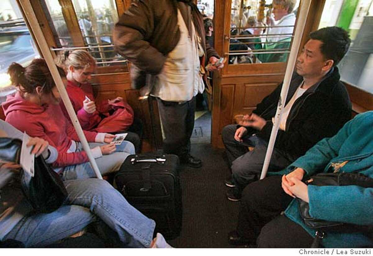 _R6V6308.JPG A conductor takes tickets on a cable car. GAVIN NEWSOM is accusing cable operators of skimming money from fares. Photo taken on 1/18/06 in San Francisco, CA. Photo by Lea Suzuki/ The San Francisco Chronicle MANDATORY CREDIT FOR PHOTOG AND SF CHRONICLE/ -MAGS OUT.