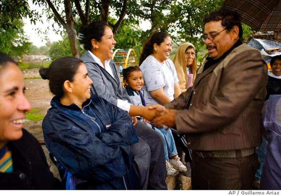 National Action Party (PAN), mayoral candidate for Mexican Jerez County and U.S. California tomato king Andres Bermudez greets women before a meeting in Lo de Luna Monday, June 28, 2004, in the Northern State of Zacatecas, Mexico. Migrants running in Zacatecas state elections on Sunday represent different parties but they're united in efforts to turn the economic power of 1.5 million Zacatecans living in the United States into a political force.(AP Photo/Guillermo Arias) Ran on: 07-02-2004  Andres Bermudez, who made a fortune in the United States, campaigns in Jerez, Mexico. Ran on: 01-19-2006  Andres Bermudez, mayor of Jerez, Mexico, got his &quo;Tomato King'' alias from his three decades as a farmer in California. Photo: GUILLERMO ARIAS