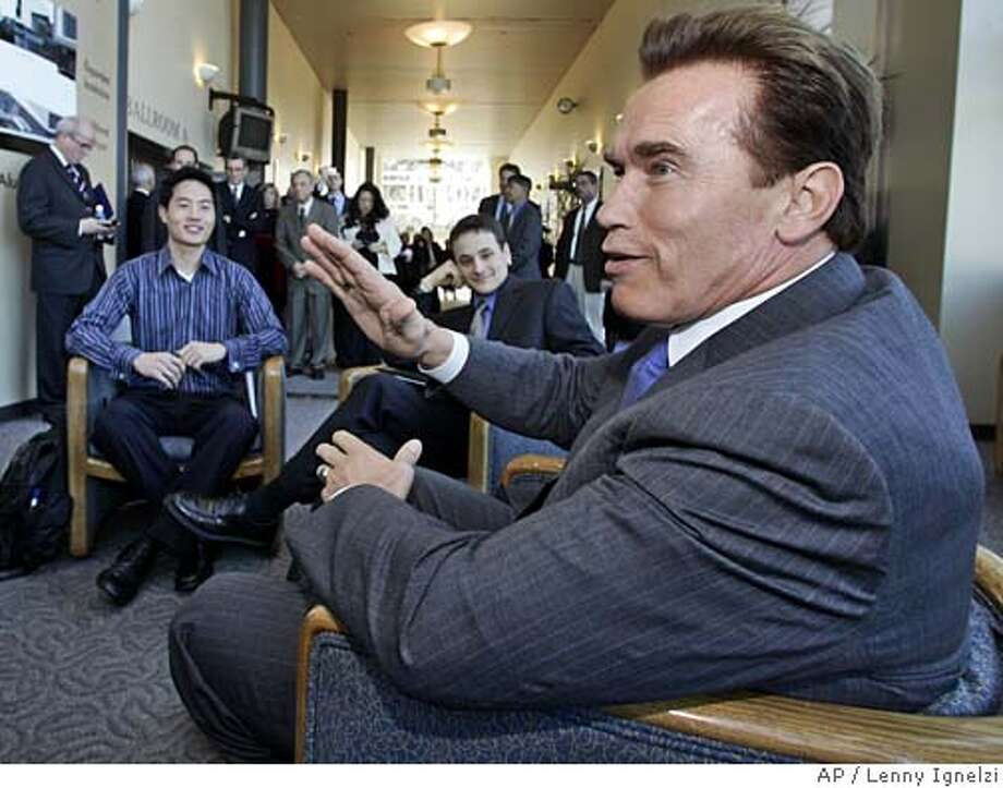 California Gov. Arnold Schwarzenegger talks with University of California students after an appearance at the regents' meeting Wednesday, Jan. 18, 2006, in San Diego. The students are Thomas Hwei, left, and Jason Miller. (AP Photo/Lenny Ignelzi, Pool) Photo: LENNY IGNELZI