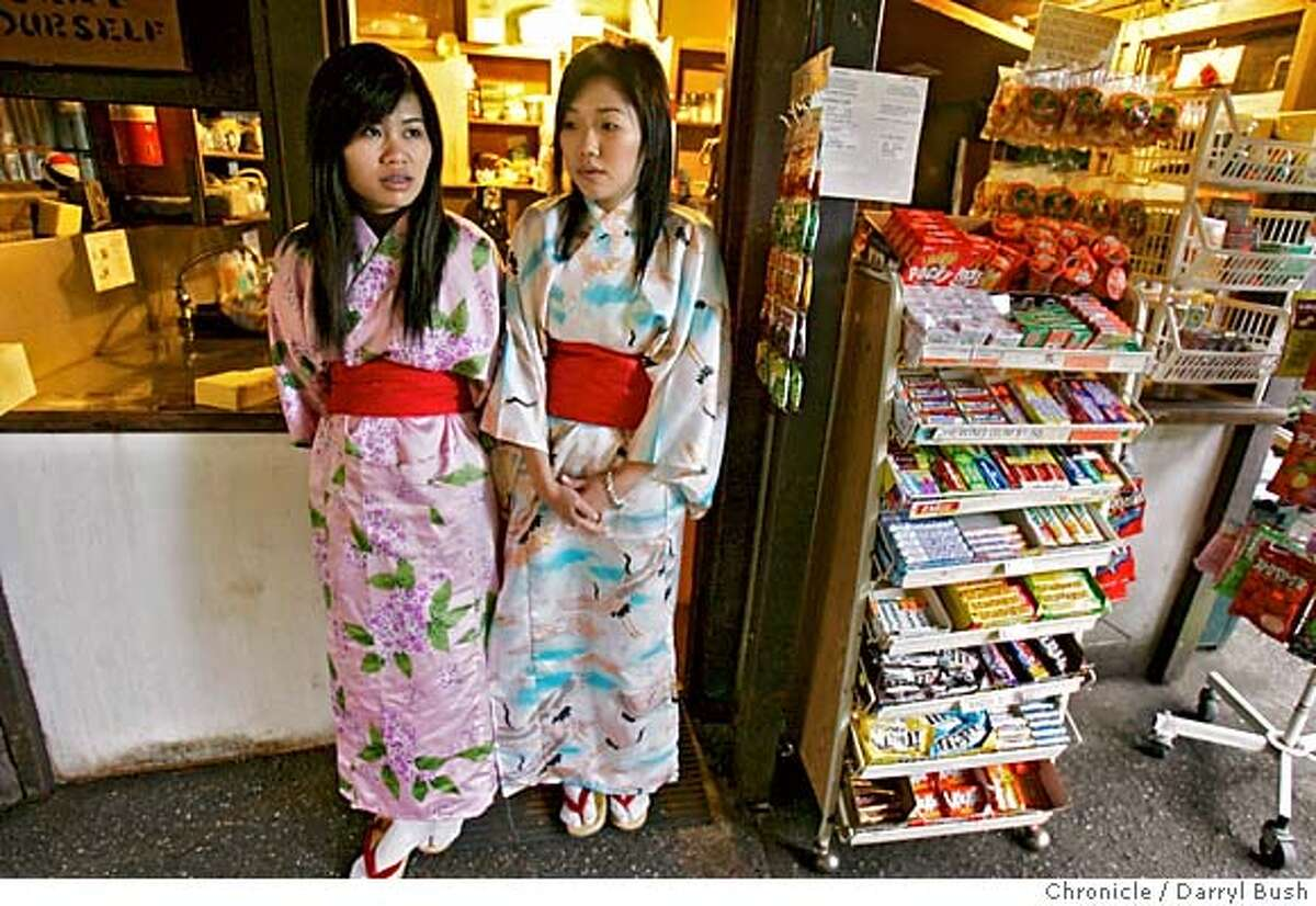 teagarden_0052_db.JPG Servers Mei Chiu, left, and Kelly Lam, wear colorful kimono style attire, standing next to snack stand, as they wait to serve customers tea and or cookies at the Japanese Tea Garden in Golden Gate Park. Event on 1/13/06 in San Francisco. Darryl Bush / The Chronicle MANDATORY CREDIT FOR PHOTOG AND SF CHRONICLE/ -MAGS OUT