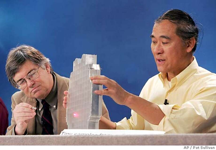 Scientist Donald Brownlee, left, uses a laser pointer on a test model of a collector tray used to collect comet and interstellar dust held by Peter Tsou during a news conference at NASA's Johnson Space Center in Houston Thursday, Jan. 19, 2006. (AP Photo/Pat Sullivan) Photo: PAT SULLIVAN