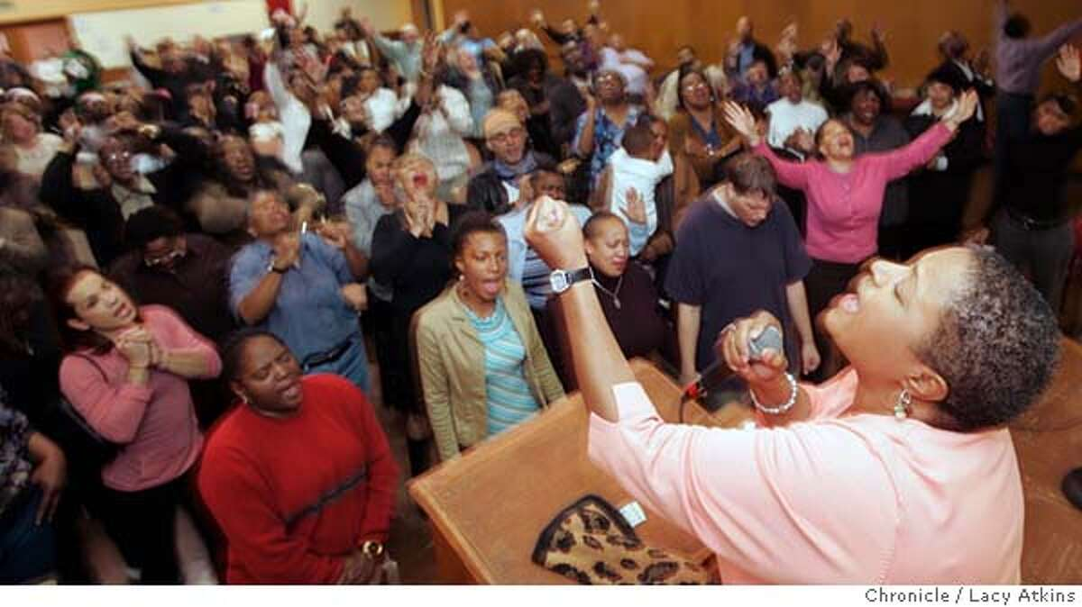 Bishop Yvette Flunder at the pulpit leads the congregation in prayer at the City of Refuge Church, during the sunday service, Jan. 14, 2006, in San Francisco. This story will advance a meeting we will attend in Atlanta between members of the African American gay and lesbian community and church leaders Jan. 19 to 21. Photo by Lacy Atkins MANDATORY CREDIT FOR PHOTOG AND SF CHRONICLE/ -MAGS OUT