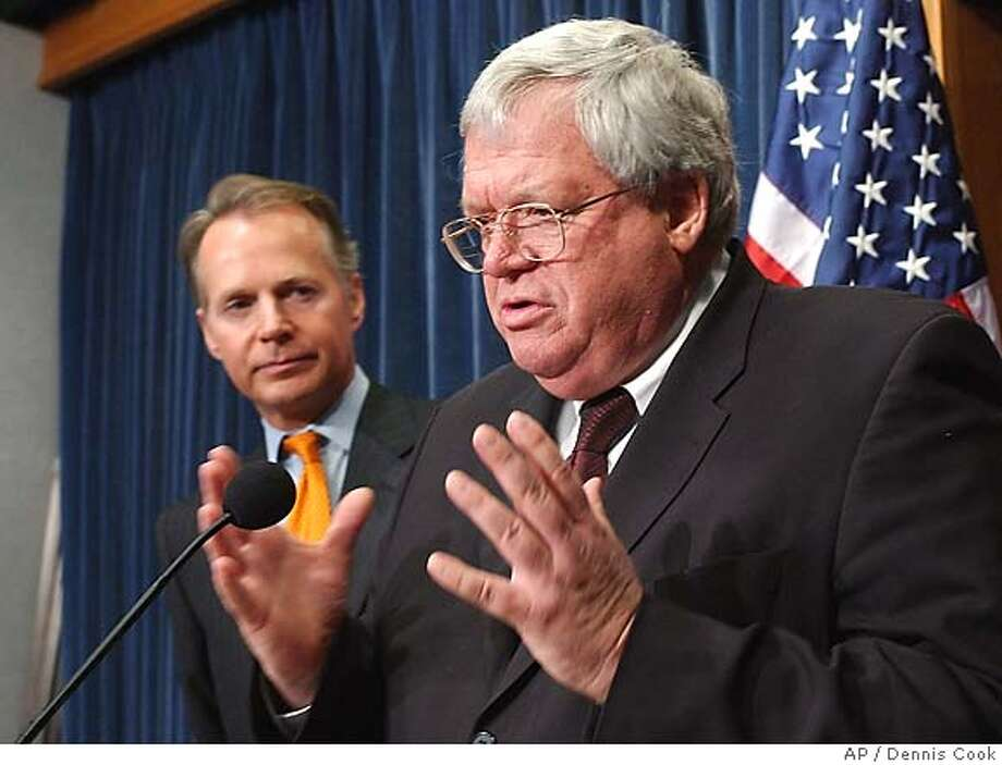 House Speaker Dennis Haster, R-Ill., and Rep. David Dreier, R-Calif, left, appear at a news conference on Capitol Hill Tuesday, Jan. 17, 2006, to discuss plans to clean up tranished relations between lawmakers and lobbyists. House Republicans moved to seize the initiative for ethics reform Tuesday with a comprehensive package of changes, including the banning of privately sponsored travel like that arranged by convicted lobbyist Jack Abramoff. (AP Photo/Dennis Cook) Photo: DENNIS COOK