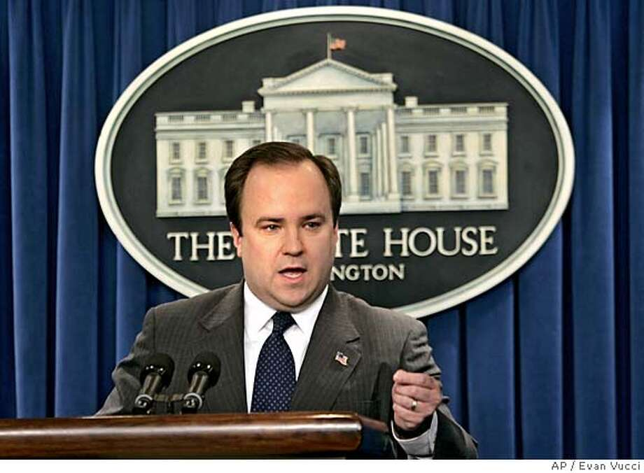 "White House press secretary Scott McClellan gestures during a press briefing on Tuesday, Jan. 17, 2006 in Washington. The White House accused former Vice President Al Gore of hypocrisy Tuesday for his assertion that President Bush broke the law by eavesdropping on Americans without court approval. ""If Al Gore is going to be the voice of the Democrats on national security matters, we welcome it,"" said White House press secretary Scott McClellan. (AP Photo/Evan Vucci) Photo: EVAN VUCCI"