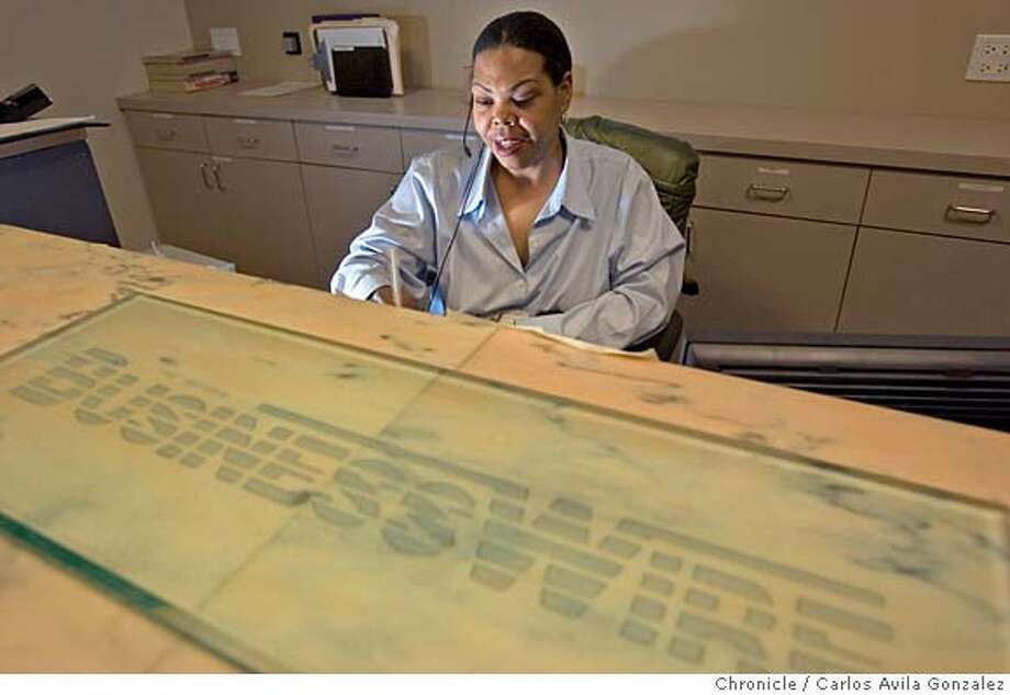 BUSINESSWIRE_003_CAG.CR2  Kim Garner, receptionist of BusinessWire, in the company's San Francisco headquarters on Tuesday, January 17, 2005. Warren Buffett just bought Business Wire, a San Francisco company. Photo by Carlos Avila Gonzalez / The San Francisco Chronicle  Photo taken on 1/17/06 in San Francisco, CA. MANDATORY CREDIT FOR PHOTOG AND SAN FRANCISCO CHRONICLE/ -MAGS OUT Photo: Carlos Avila Gonzalez