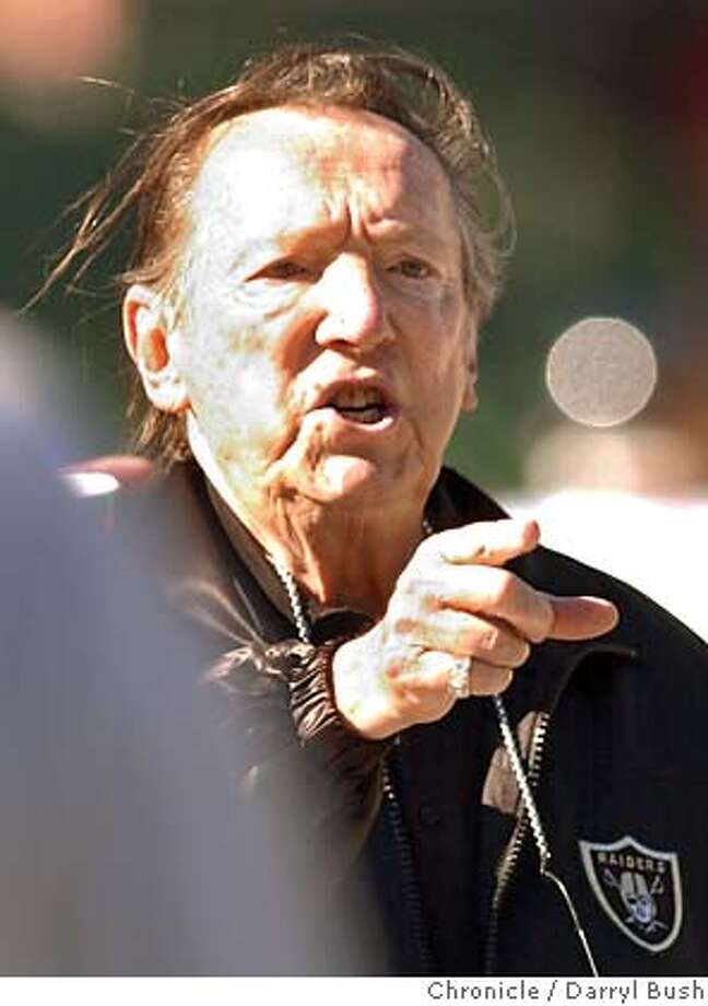 raiders014_db.jpg  Oakland Raiders owner Al Davis yells encouragement to players during warm-up drills game at Network Associates Coliseum. 8/8/03 in Oakland.  DARRYL BUSH / The Chronicle Al Davis has built his stake in the Raiders to the point that he owns 37 percent of the voting stock in the team. Photo caption  ratto16_ph1060214400The Chronicleraiders014_db.jpg_Oakland Raiders owner Al Davis yells encouragement to players during warm-up drills game at Network Associates Coliseum._ 8-8-03 in Oakland._DARRYL BUSH - The Chronicle__CAT O SALES-MAGS OUT Al Davis has built his stake in the Raiders to the point that he owns 37 percent of the actual stock in the team. Photo caption onthenflsky23_PH1060214400The Chronicleraiders014_db.jpg_Oakland Raiders owner Al Davis yells encouragement to players during warm-up drills game at Network Associates Coliseum._ 8-8-03 in Oakland._DARRYL BUSH - The Chronicle__Al Davis has built his stake in the Raiders to the point that he owns 37 percent of the voting stock in the team. ___Photo caption  ratto16_ph1060214400The Chronicleraiders014_db.jpg_Oakland Raiders owner Al Davis yells encouragement to players during warm-up drills game at Network Associates Coliseum._ 8-8-03 in Oakland._DARRYL BUSH - The C Photo: DARRYL BUSH