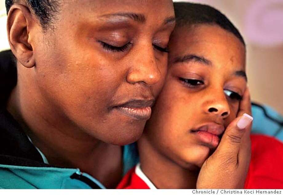 CHRISTINA KOCI HERNANDEZ/CHRONICLE  Sheila Burton with son, R.J.,age 8, brother of Rashad. R. J. Sheila Burton , mother of Rashad Williams, was shot to death in december during a home-invasion robbery he and 2 friends allegedly committed in clearlake. rashad is the same kid who got national publicity in 1999, at the age of 15, for raising money, by racing in the bay to breakers, for a victim of the columbine massacre. story is about how his life unraveled. Photo: CHRISTINA KOCI HERNANDEZ