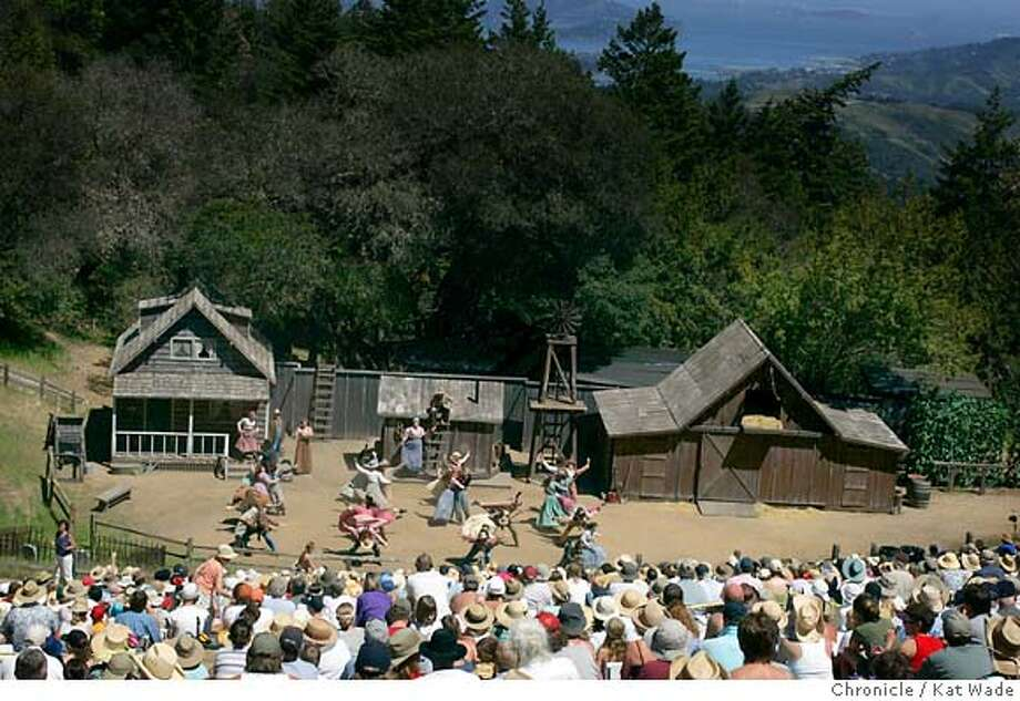 """NBOAKLAHOMA_3462_KW.jpg  On 5/22/05 in the Mt. Tamalpais (L to R) during the Rodgers and Hammerstein number """"The Farmer and the Cowmen Should be Friends"""" the audience enjoys sunny weather for the opening day performance of the Mountain Play's, Oklahoma! on the top of Mt. Tamalpais at the Cushing Memorial Amphitheater Sunday afternoon. Kat Wade/ The Chronicle MANDATORY CREDIT FOR PHOTOG AND SF CHRONICLE/ -MAGS OUT Photo: Kat Wade"""