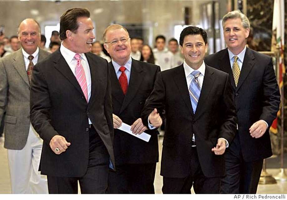 California Gov. Gov. Arnold Schwarzenegger, second from left, laughs at a coment made by Assembly Speaker Fabian Nunez, D-Los Angeles, second from right, as they walk to a joint news conferece held at the Capitol in Sacramento, Calif., Tuesday, Jan. 17, 2006. Schwarzenegger, and Nunez, along with Senate Minority Leader Dick Ackerman, R-Tustin, left, Senate President Pro Tem Don Perata, D-Oakland, third from left, and Assembly Minority Leader Kevin McCarthy, R-Bakersfield, right, announced they would pass legislation this week authorizing the state to temporarily cover the cost of medications for senior citizens wrongly denied coverage by the federal governement's new Medicare prescription drug plan.(AP Photo/Rich Pedroncelli) ACKERMAN SCHWARZENEGGER PERATA NUNEZ MCCARTHY Photo: RICH PEDRONCELLI