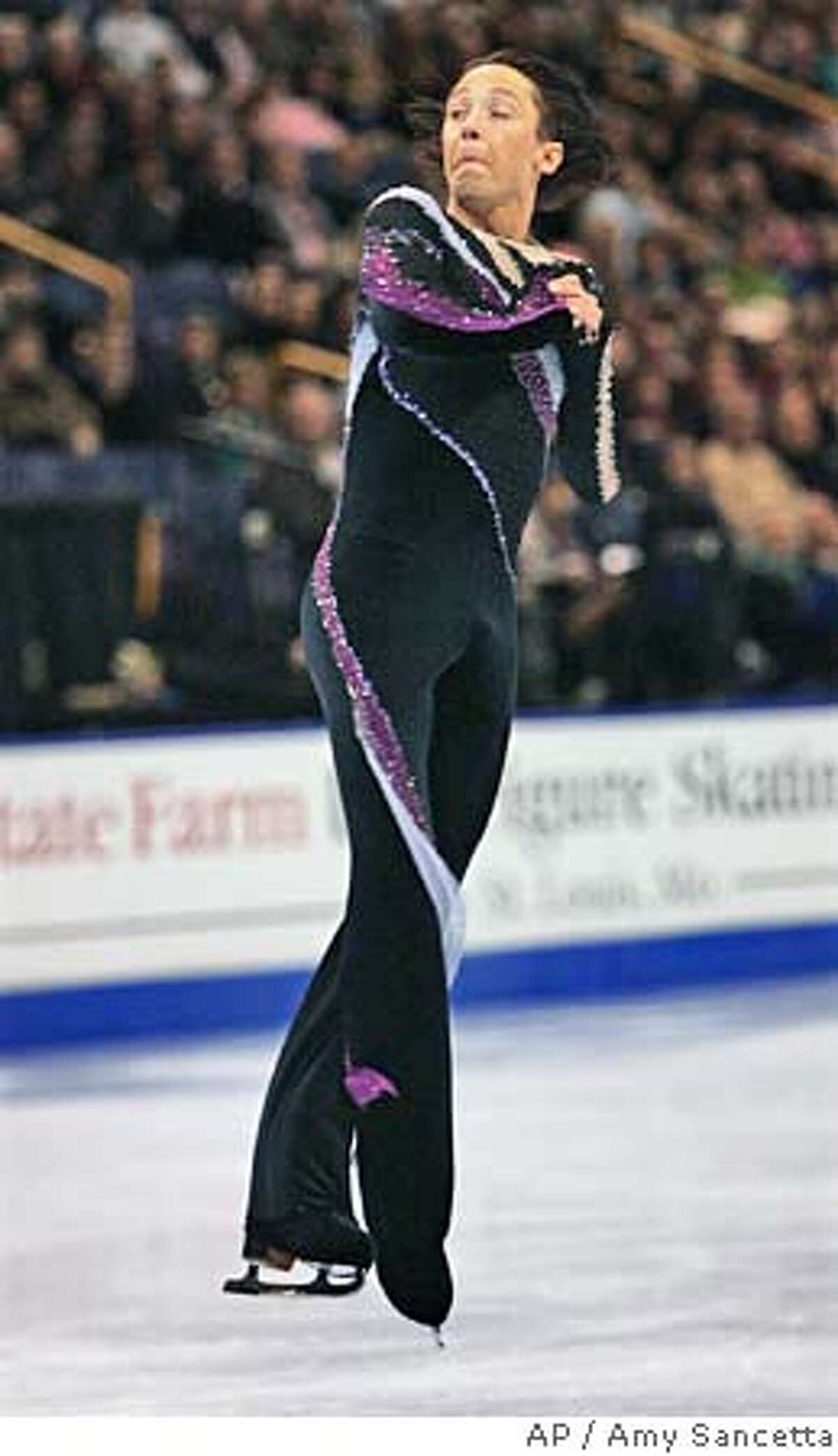 Two-time U.S. figure skating champion Johnny Weir, from Newark, Del., completes a lutz during mens free skate event at the U.S. Figure Skating Championships in St. Louis, Saturday, Jan. 14, 2006. Weir finished in first place to earn a place on the U.S. Olympic team. (AP Photo/Amy Sancetta)