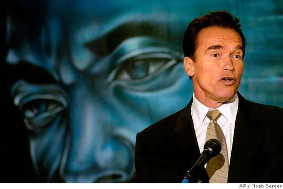 California Gov. Arnold Schwarzenegger speaks at a breakfast honoring civil rights leader Dr. Martin Luther King, Jr. on Monday, Jan. 16, 2006, in San Francisco. Speaking in front of a painting of King, Schwarzenegger described the influence the activist has had on him. (AP Photo/Noah Berger) Photo: NOAH BERGER