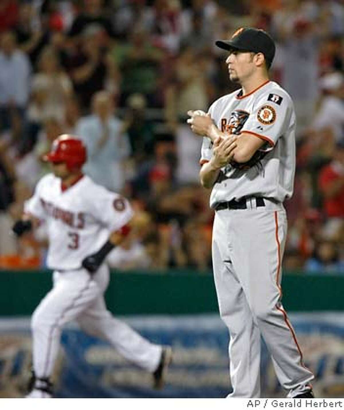San Francisco Giants pitcher Jonathan Sanchez watches as Washington Nationals' Jesus Flores rounds third base after giving up a solo homer in the fifth inning of a baseball game at RFK Stadium in Washington, Saturday, Sept. 1, 2007. (AP Photo/Gerald Herbert)