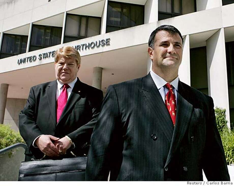 Former Washington lobbyist Jack Abramoff (R) and his lawyer Neal Sonnett leave the Miami Courthouse in Miami in this August 18, 2005 file photo. U.S. President George W. Bush's re-election campaign will give to charity $6,000 in contributions linked to a lobbyist at the center of a mounting corruption scandal, the Republican National Committee said on January 4, 2006. Abramoff pleaded guilty to fraud charges on January 3 and agreed to help U.S. prosecutors in a corruption probe that could involve several top Republican lawmakers, including former House of Representatives Majority Leader Tom DeLay of Texas. REUTERS/Carlos Barria/Files 0 Photo: CARLOS BARRIA